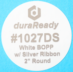 "DuraReady's #1027DS, 2"" round white BOPP label with silver print."